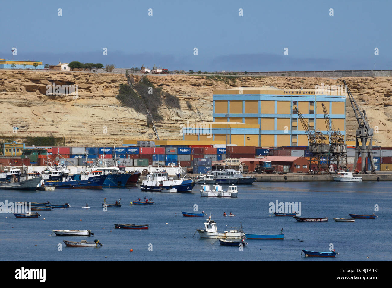 Fishing boats and cargo ships anchored in the port of Namibe. Namibe Province, Southern Angola. Africa. © Zute - Stock Image