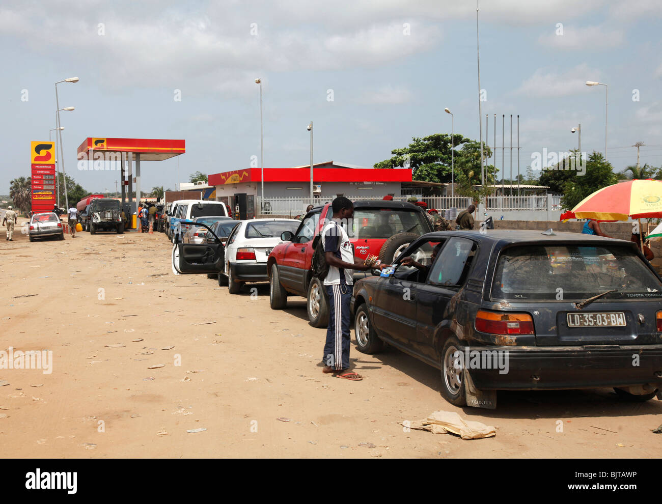 Vehicles join large queues of Angolans waiting for petrol or diesel. Luanda, Angola. Africa. Pictures © Z & - Stock Image