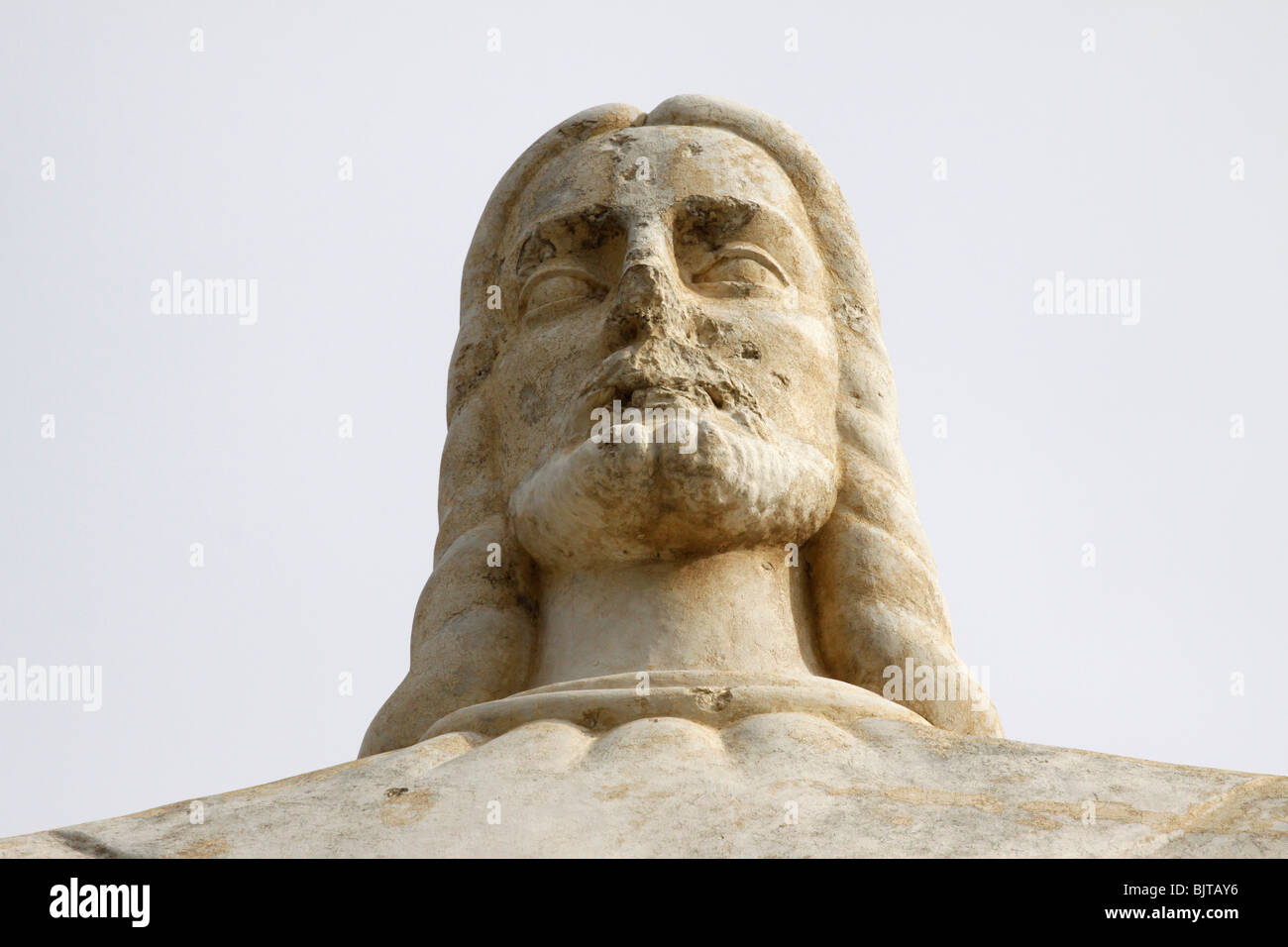 A close-up showing the war damage (bullet marks) to the Statue of Christ at Ponta do Lubango. Huila Province, Angola. - Stock Image