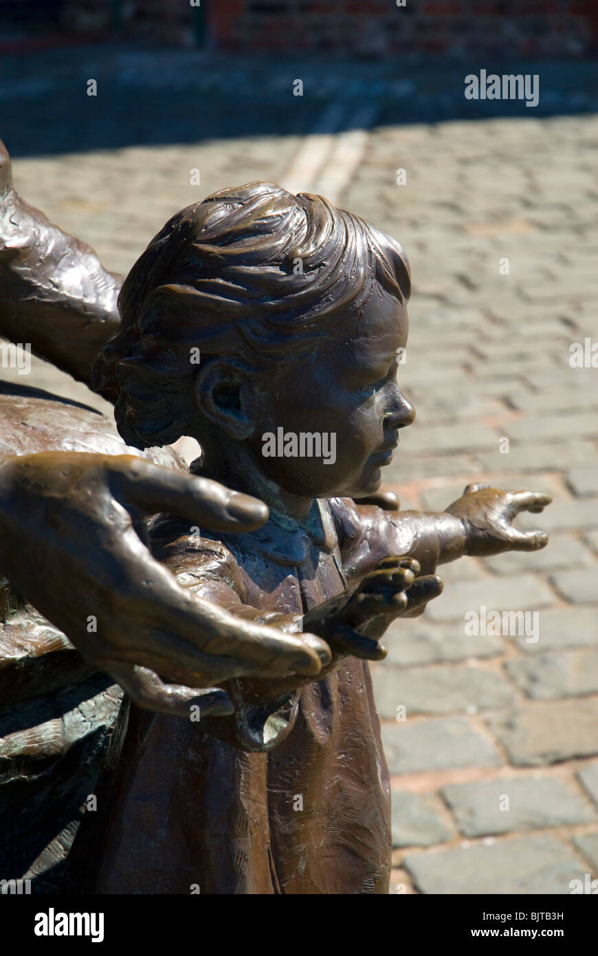 Emigrants. A sculpture by Tony Siebenthaler.  Pier Head, Liverpool, England UK - Stock Image