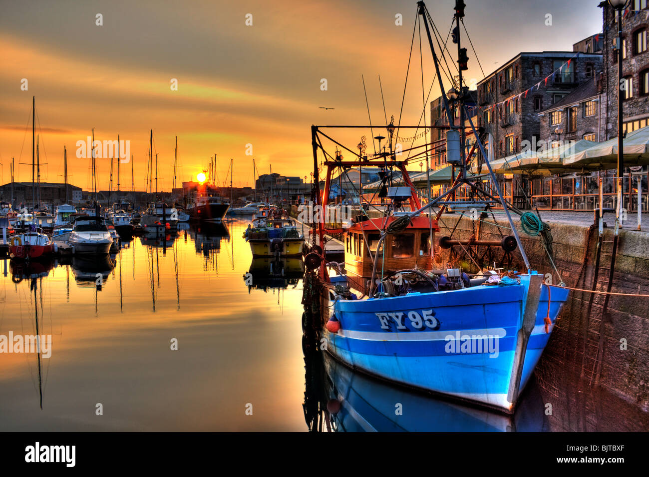 Early morning sunrise over The Barbican Plymouth UK - Stock Image