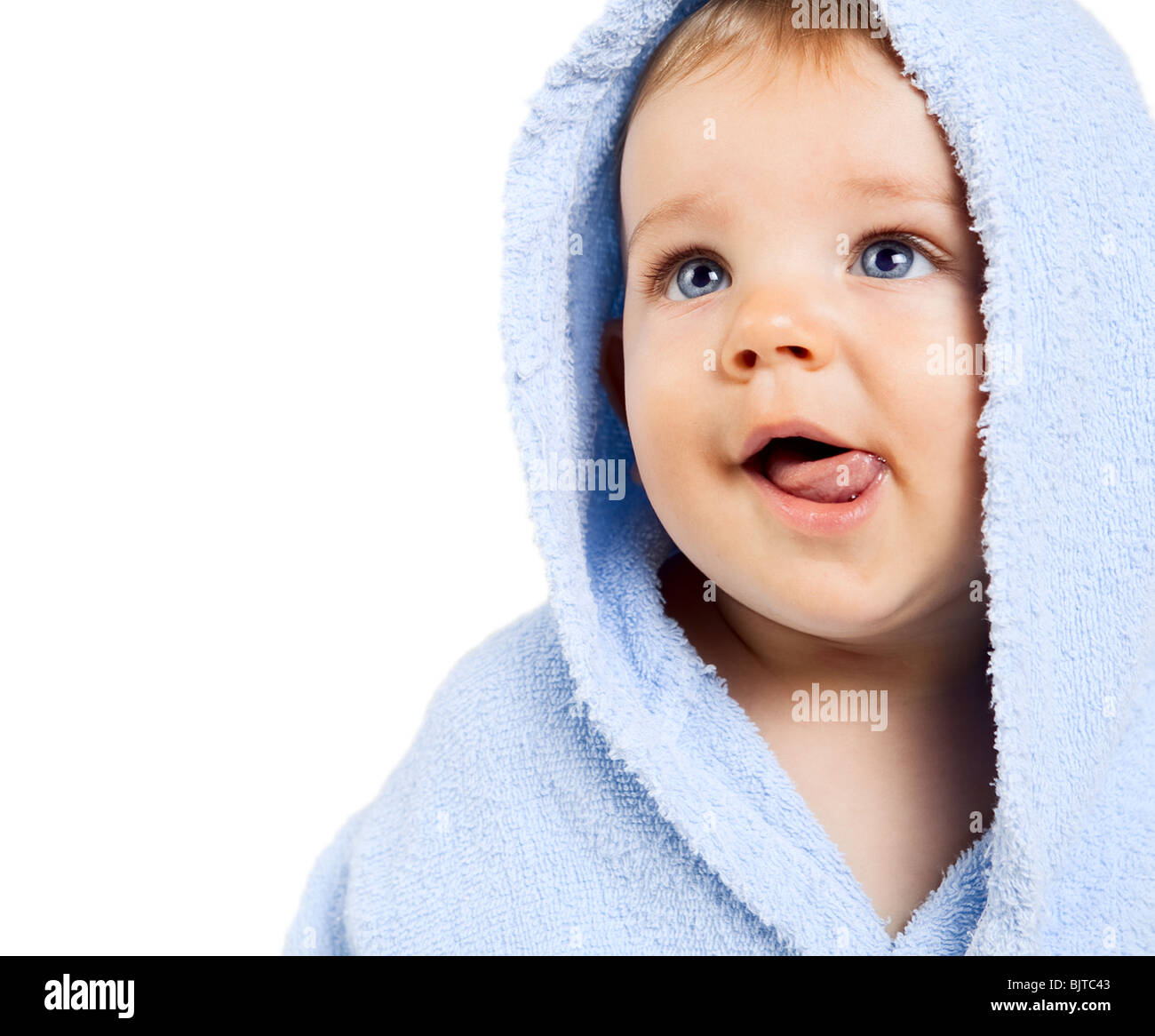 Hungry baby boy with tongue out isolated on white - Stock Image