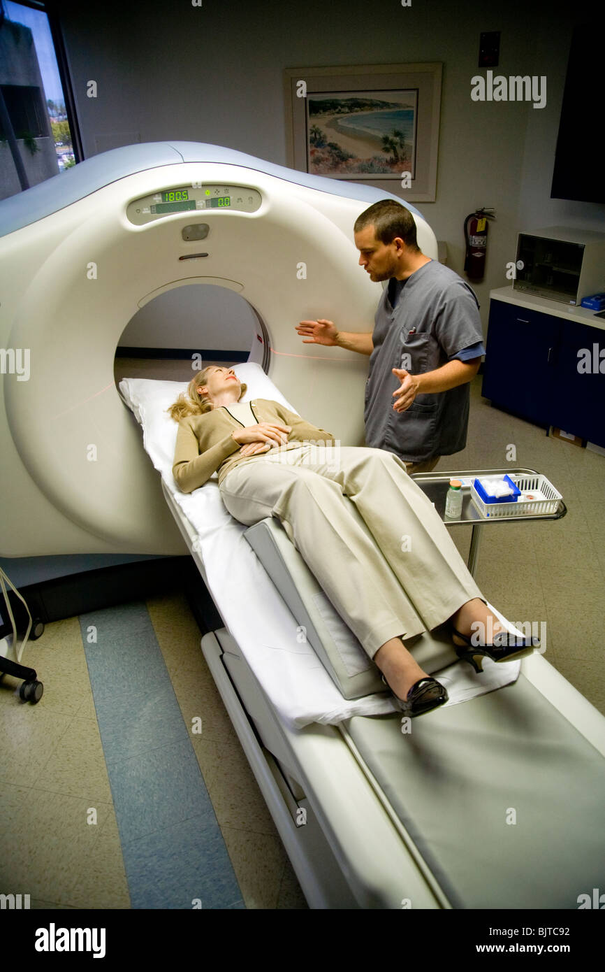 A medical technician prepares a patient for a CT examination at a California radiology clinic using a multi-slice - Stock Image