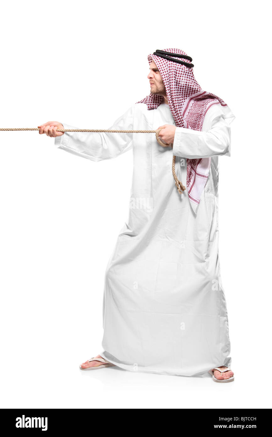 An Arab person pulling a rope - Stock Image