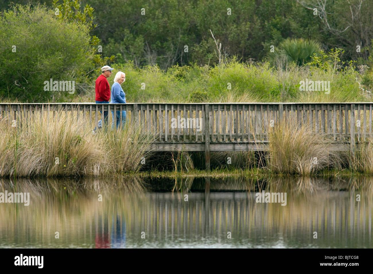 Couple walking at Bailey Tract Preserve - Sanibel Island, Florida USA - Stock Image