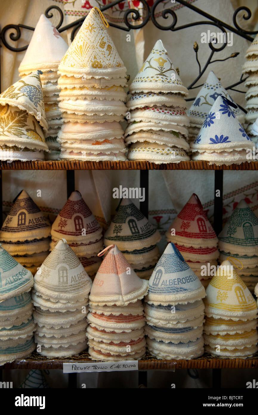 Alberobello hand made linen covers in La Botteca shop. Alberobello, Puglia, Italy. - Stock Image