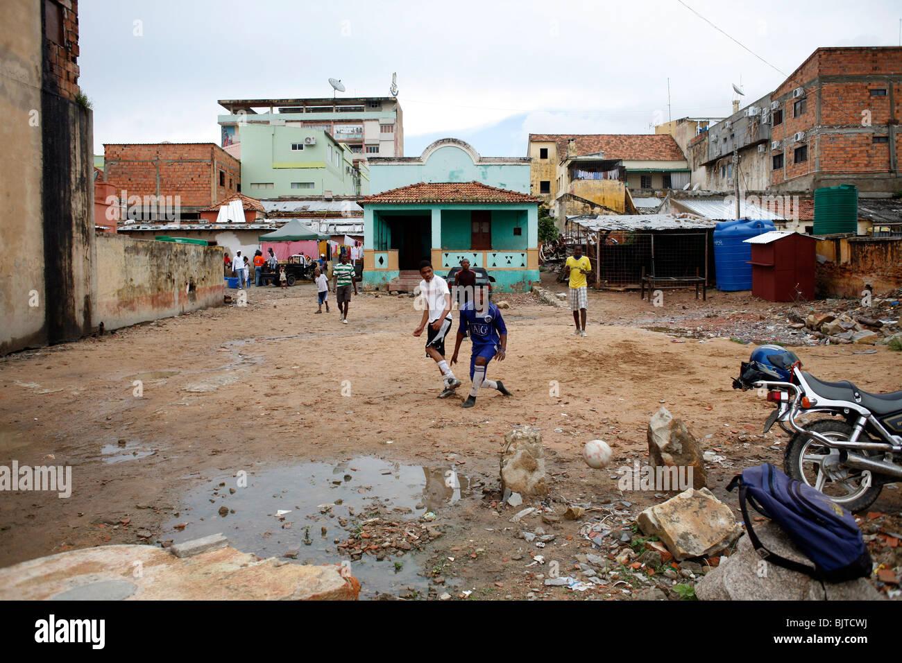 Playing football in downtown Lubango. Angola. Africa. - Stock Image