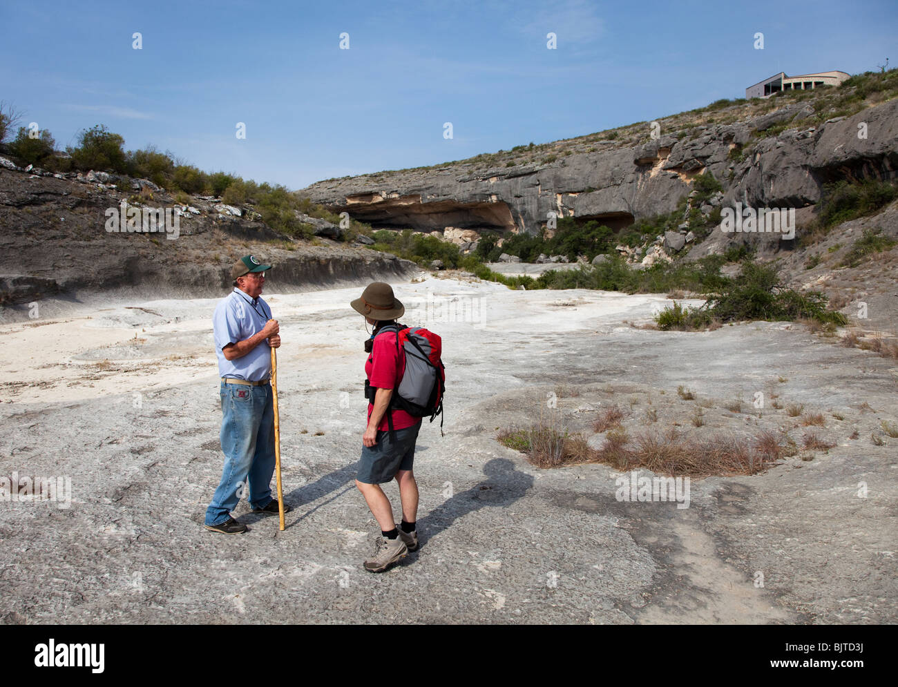 Visitor with volunteer guide in Seminole Canyon with visitor center overlooking Texas USA - Stock Image