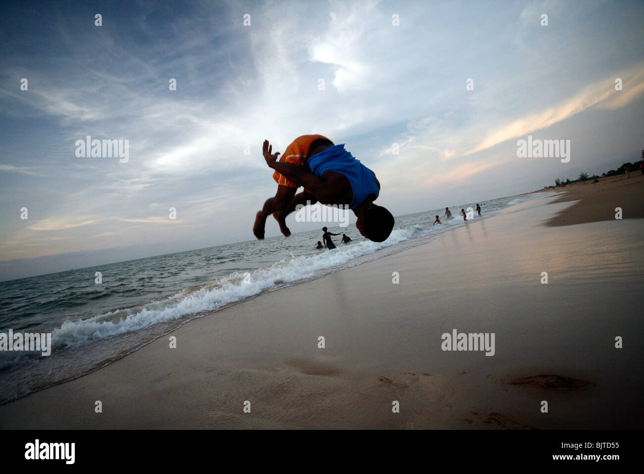 Man Doing A Back Flip On Praia Morena Benguela City Beach Angola