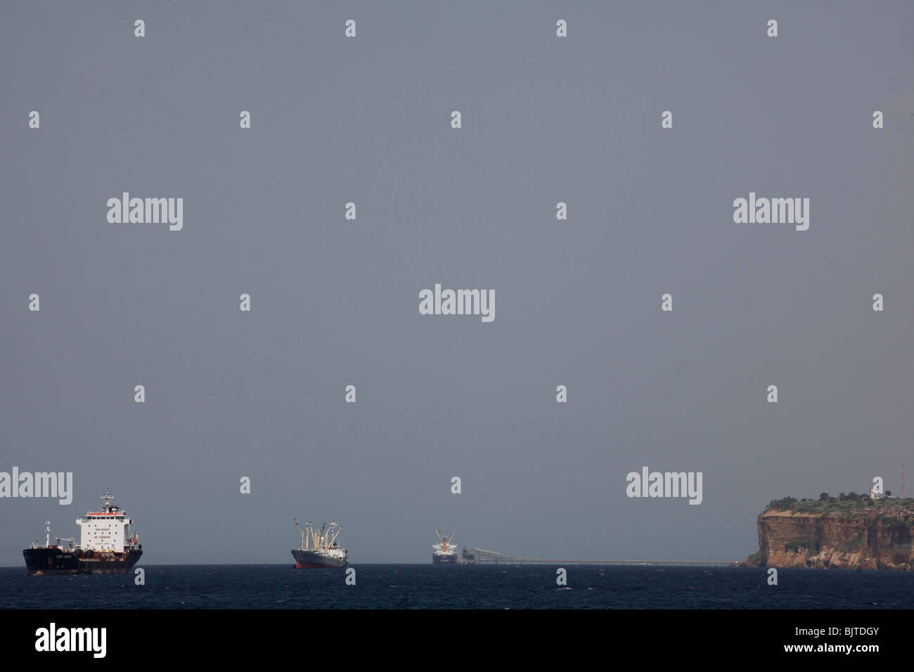 Container ships moored of the coast waiting to dock at Luanda Port. Angola. Africa. - Stock Image