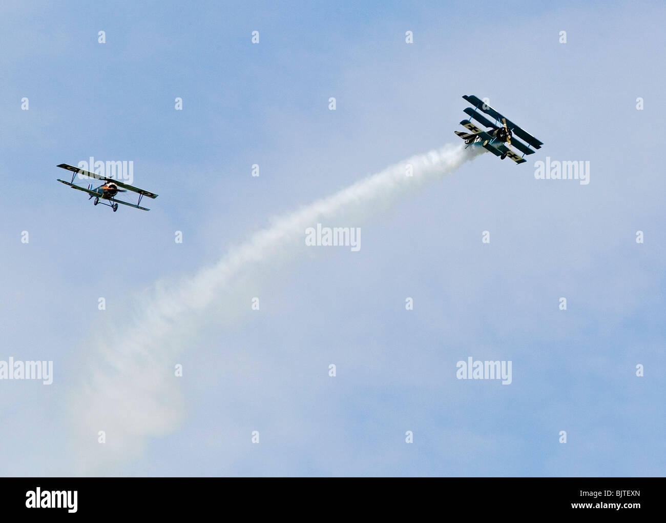 World War 1 dog fight reancctment at air show in UK Sopwith Cannel and Fokker Triplane. - Stock Image