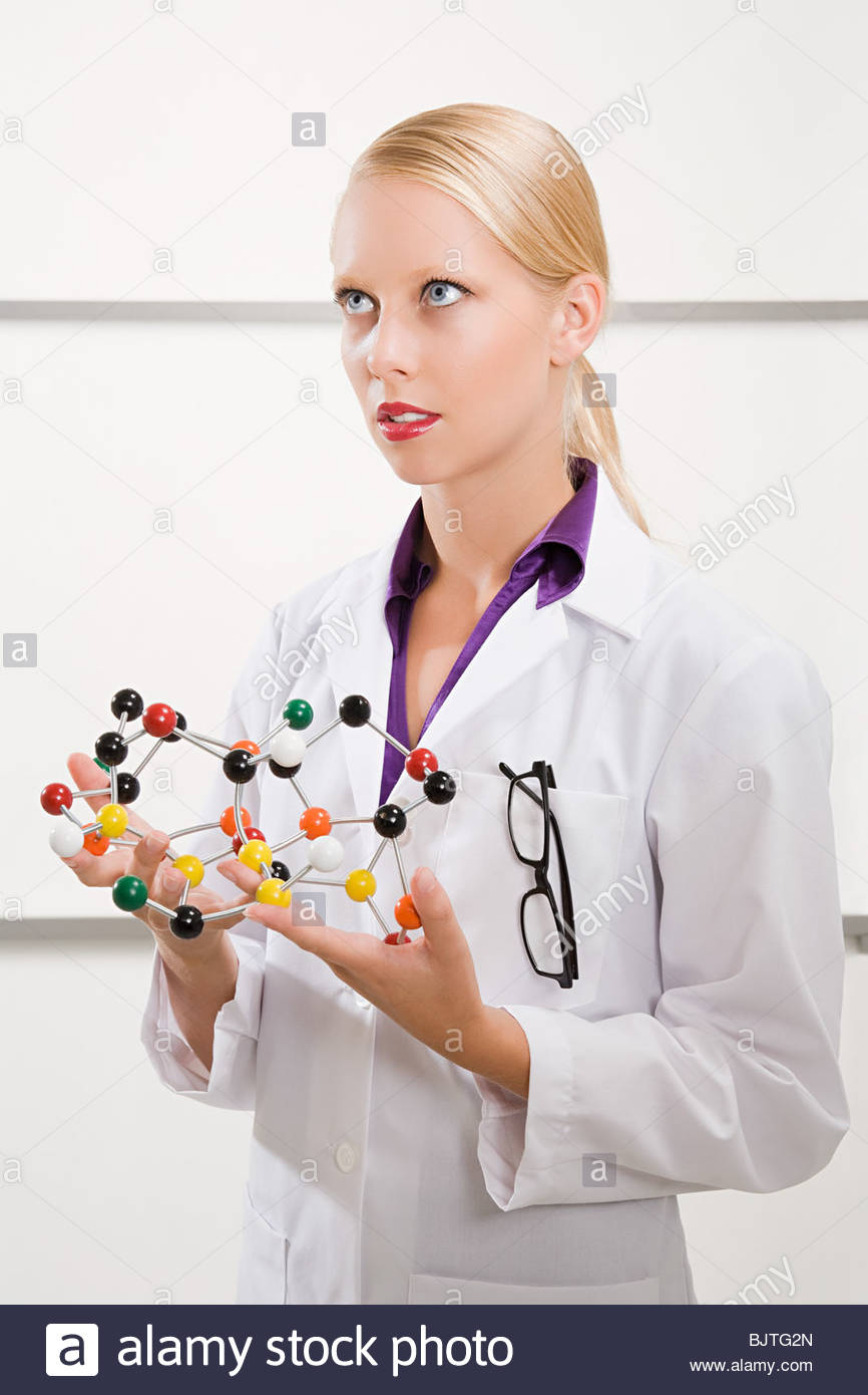 A scientist holding a dna model - Stock Image