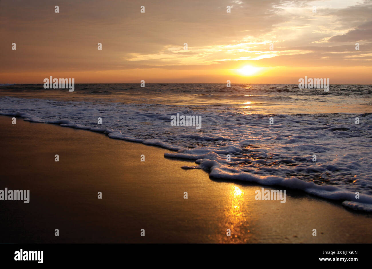 Sunset over the Atlantic ocean on the coastline of southern Angola. Stock Photo