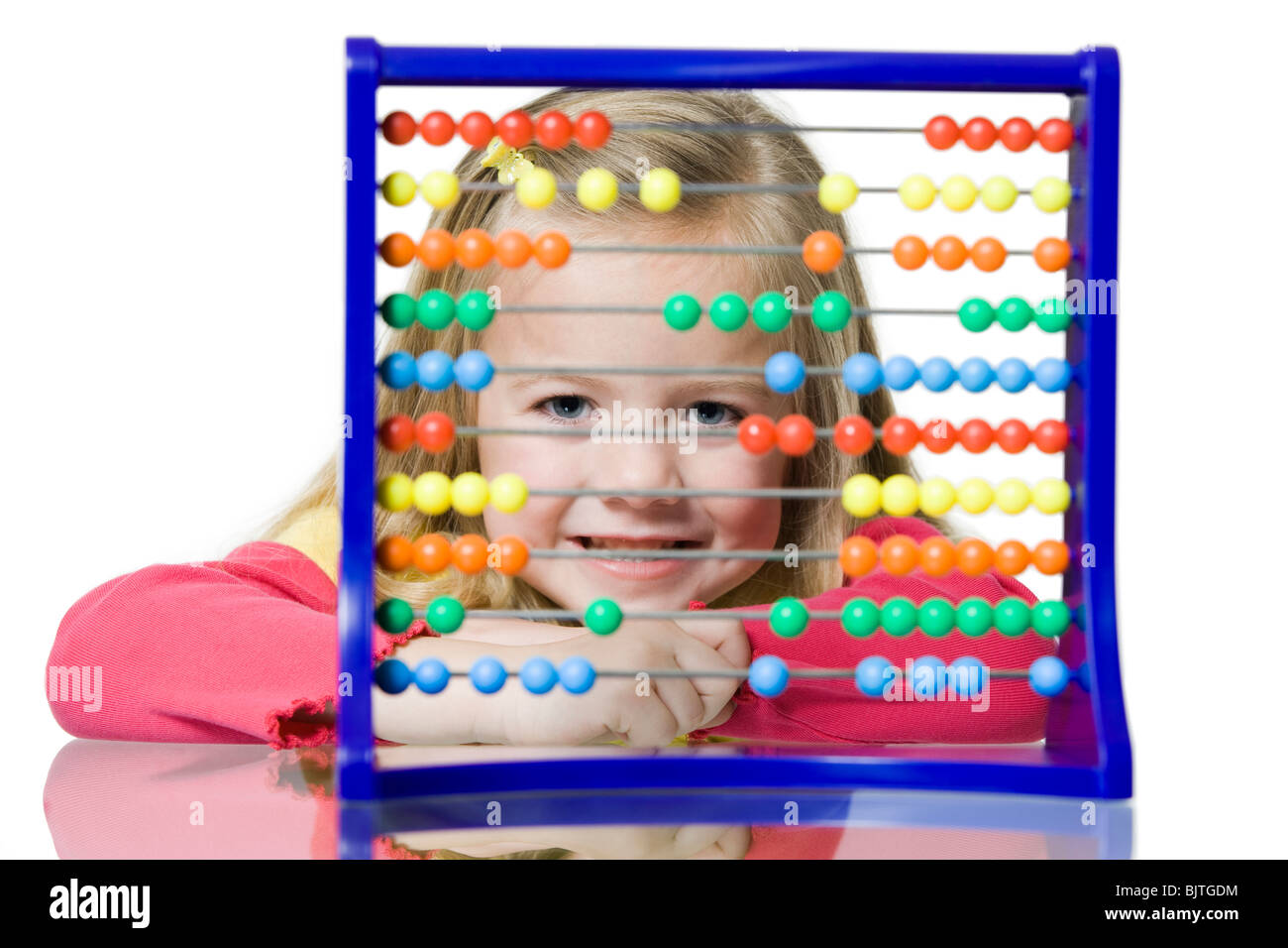 Close-up of child with counting beads - Stock Image
