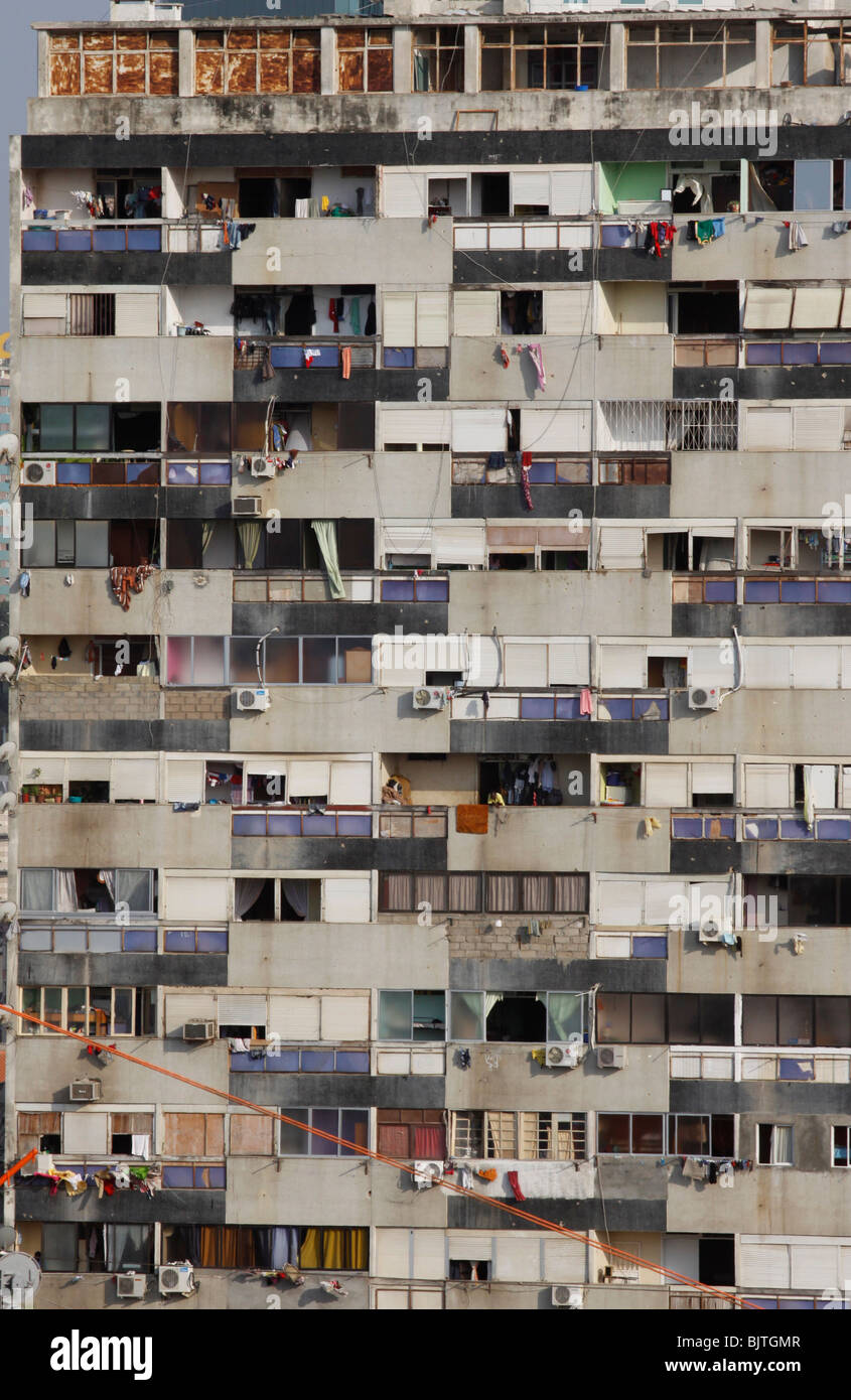 Detail of vertical slum. Run down housing apartments in a tower block in central Luanda. Angola. Africa. - Stock Image