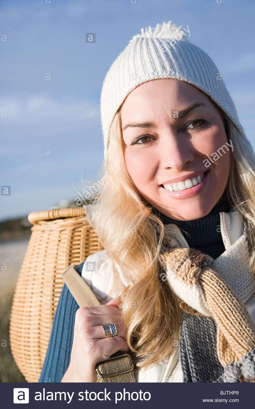 Woman in knit hat with basket - Stock Image