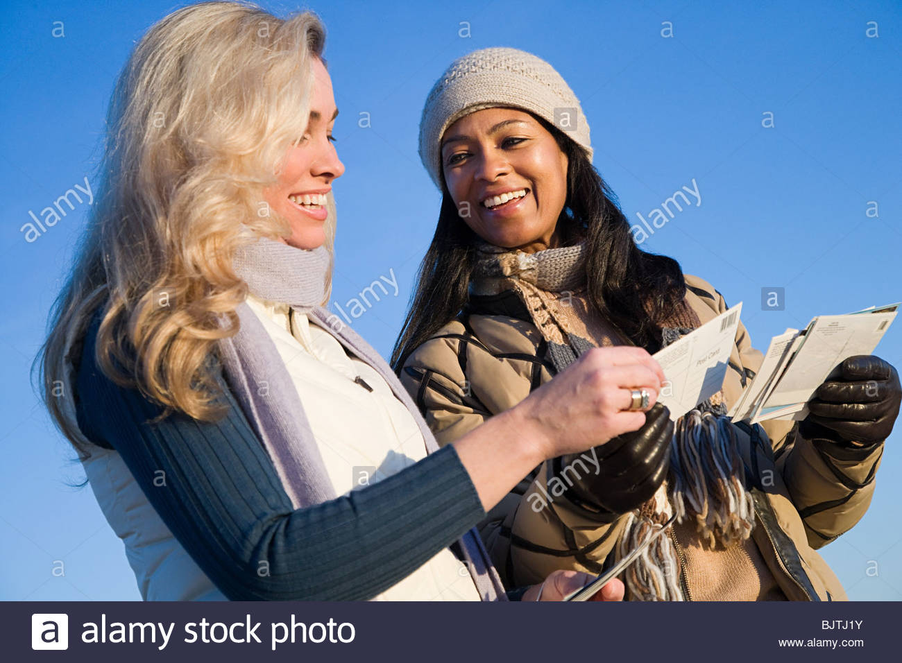 Women looking at postcards - Stock Image
