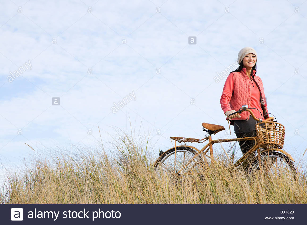 Woman with bicycle - Stock Image