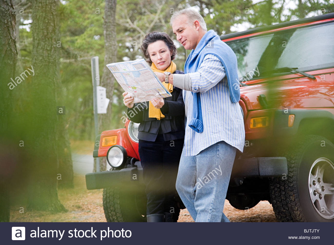 Mature couple looking at map - Stock Image