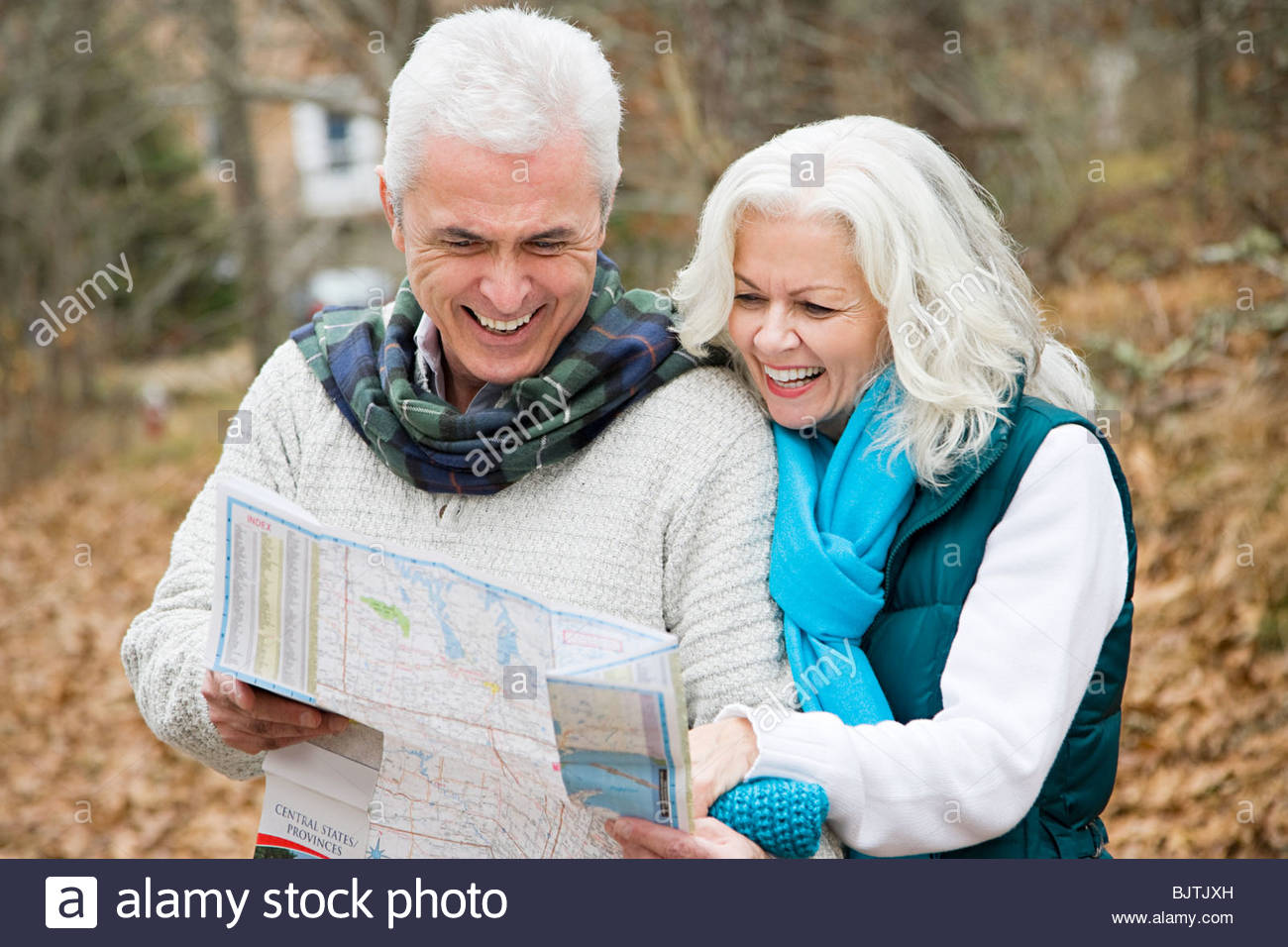 Mature couple with map - Stock Image
