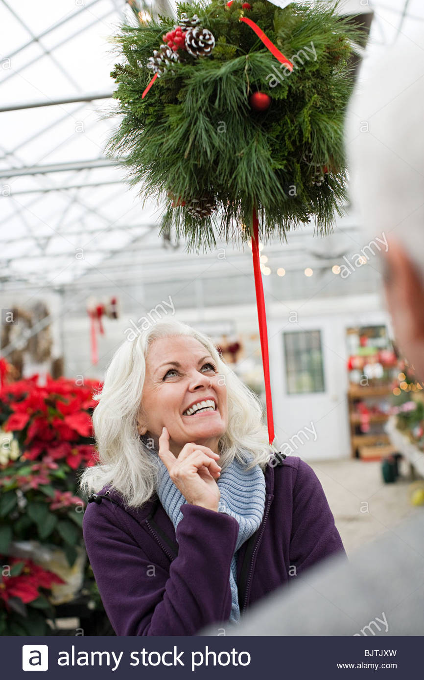 Woman looking at christmas decorations Stock Photo