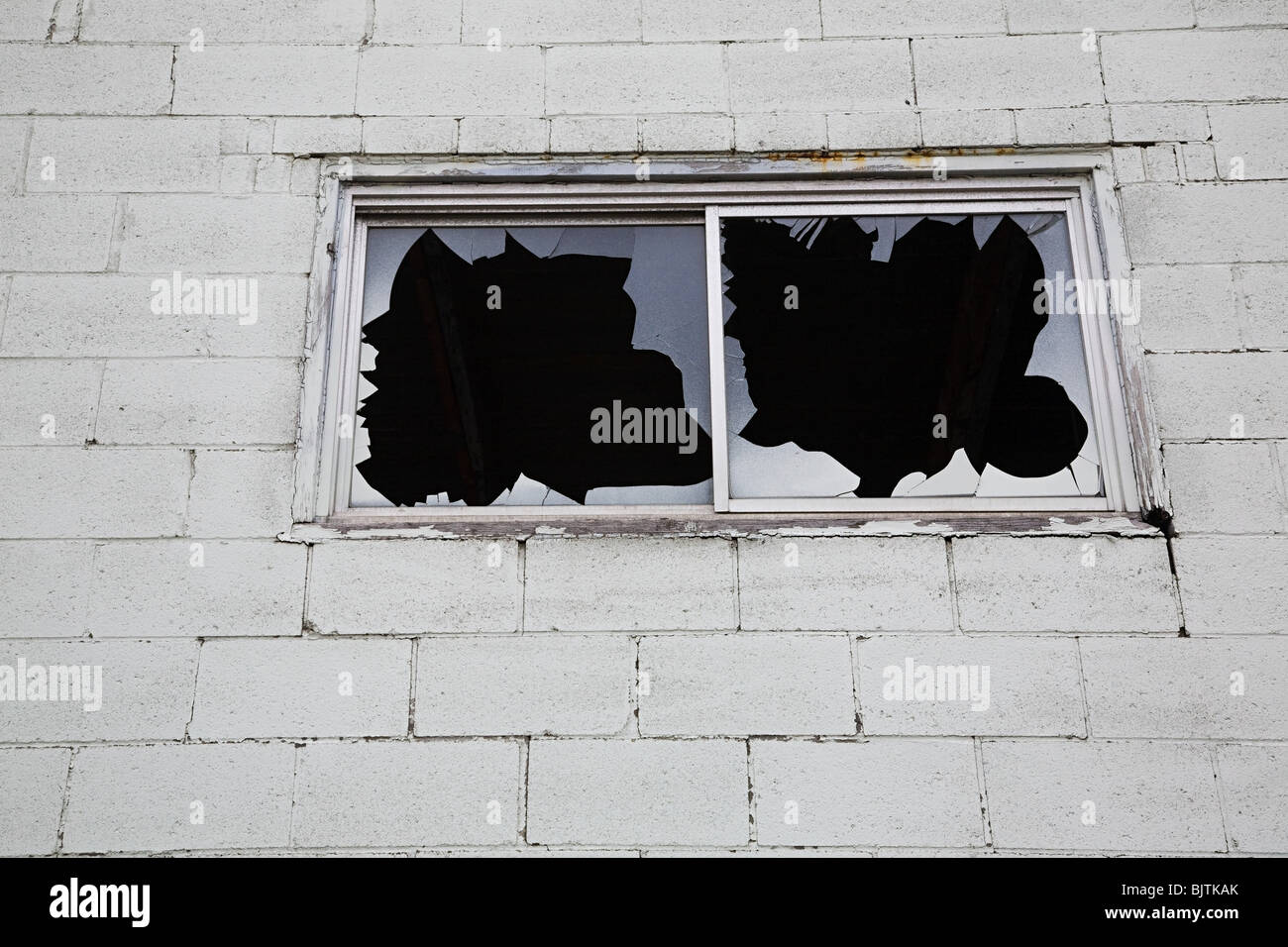 Building with broken windows - Stock Image