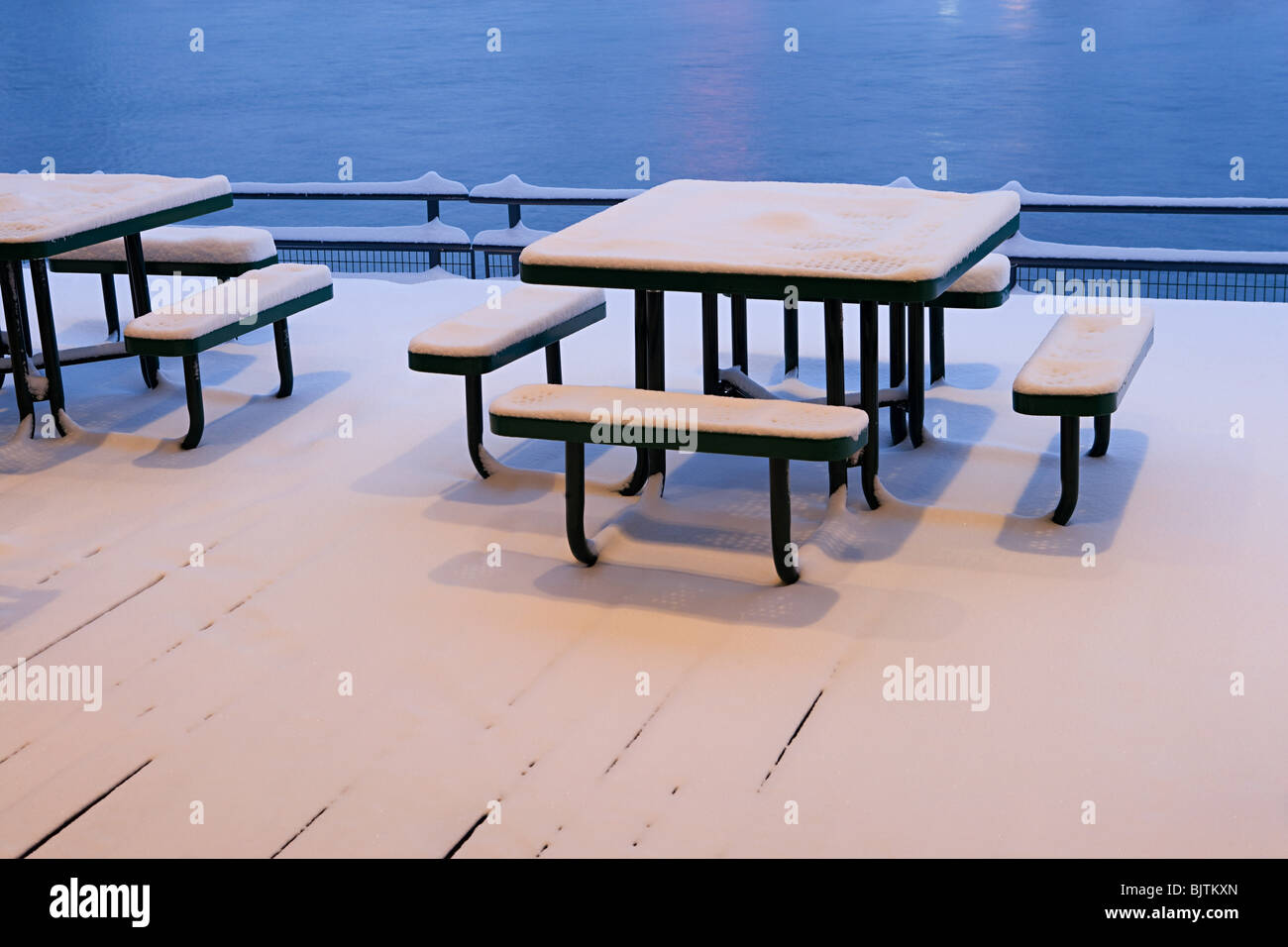 Snow covered tables and benches - Stock Image