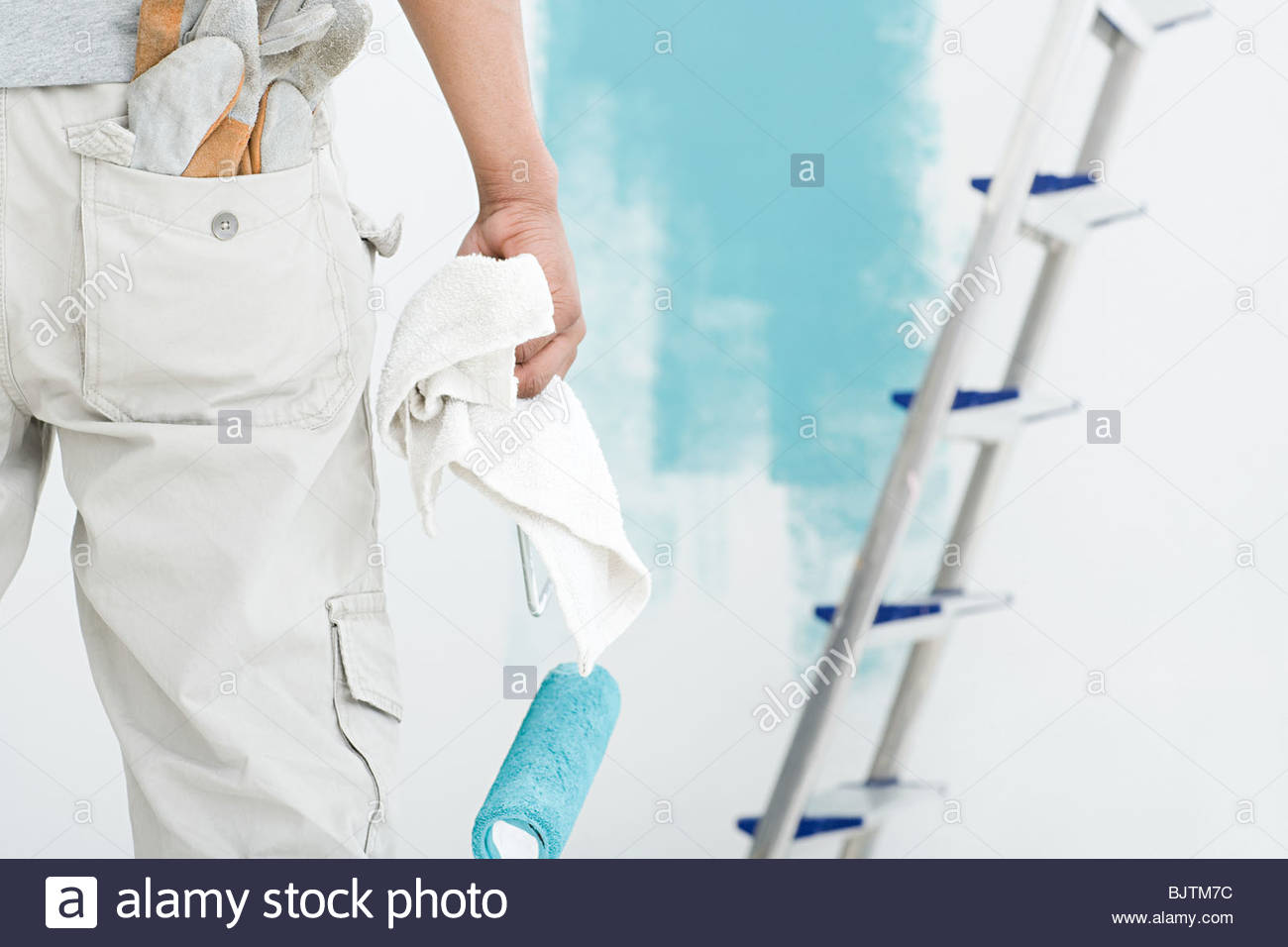 Decorator with paint roller and cloth - Stock Image