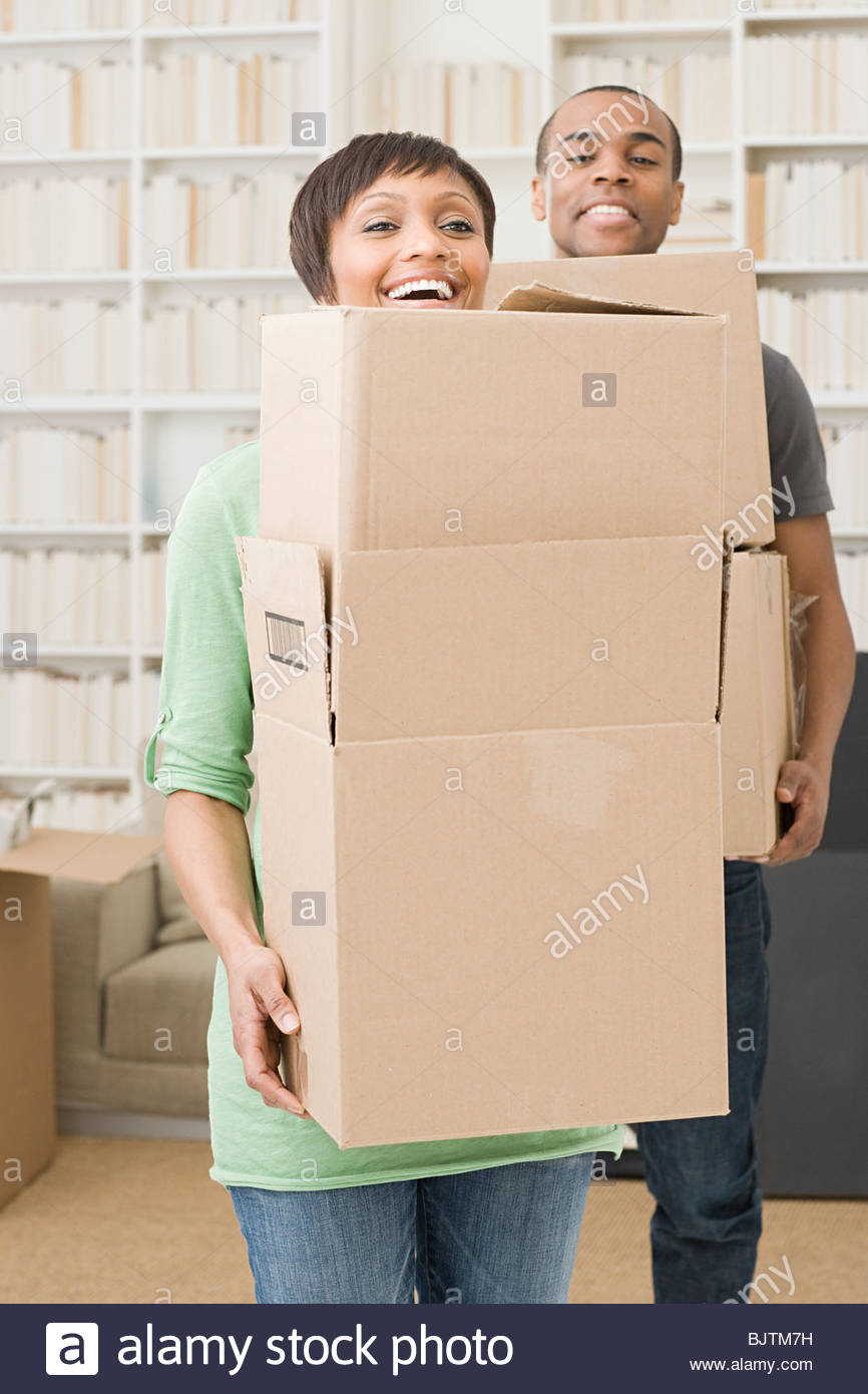 Couple with cardboard boxes - Stock Image