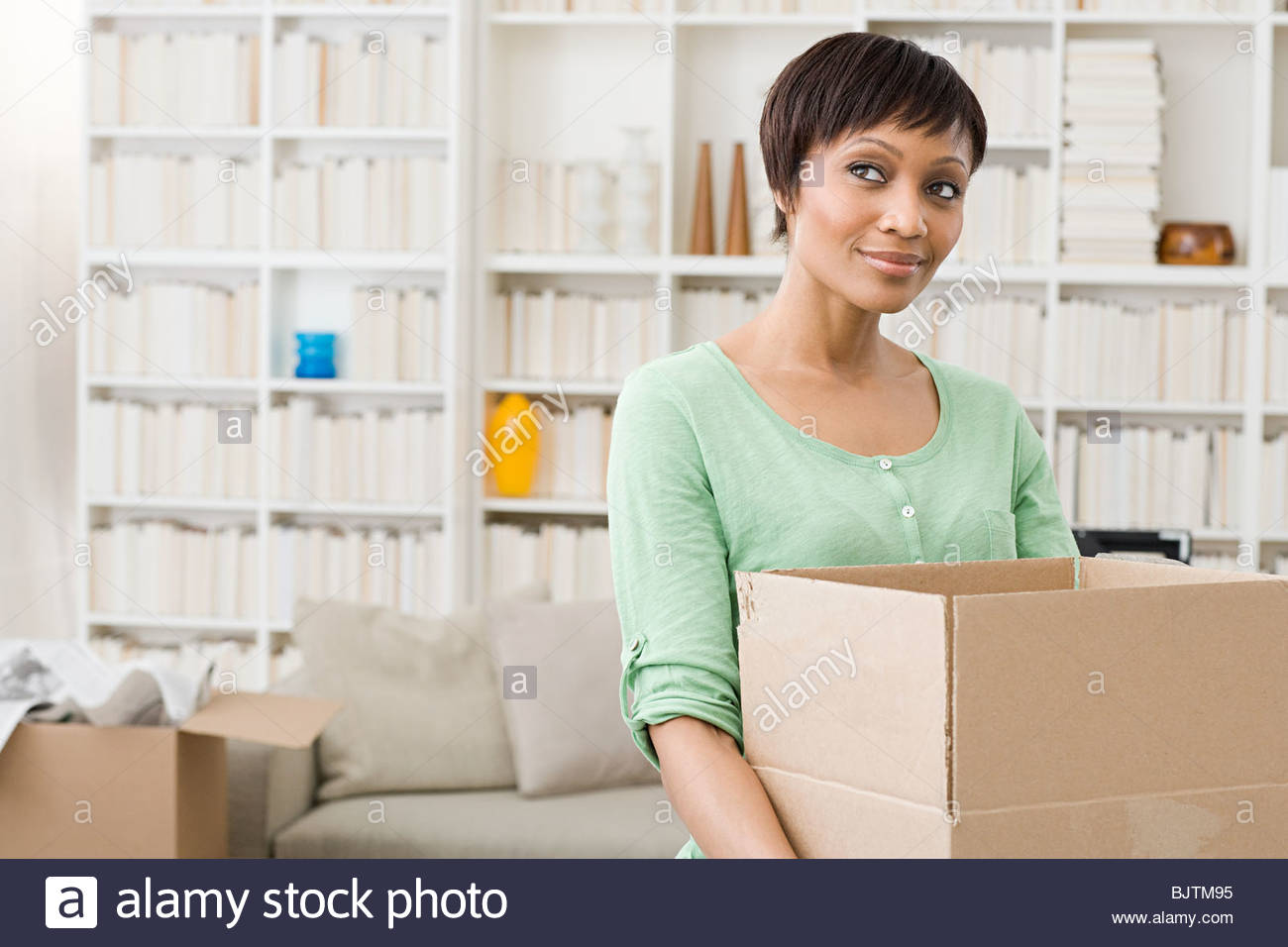 Woman with cardboard box - Stock Image