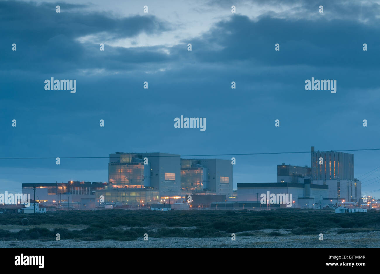 Dungeness Nuclear Power Station as the sun sets - Stock Image