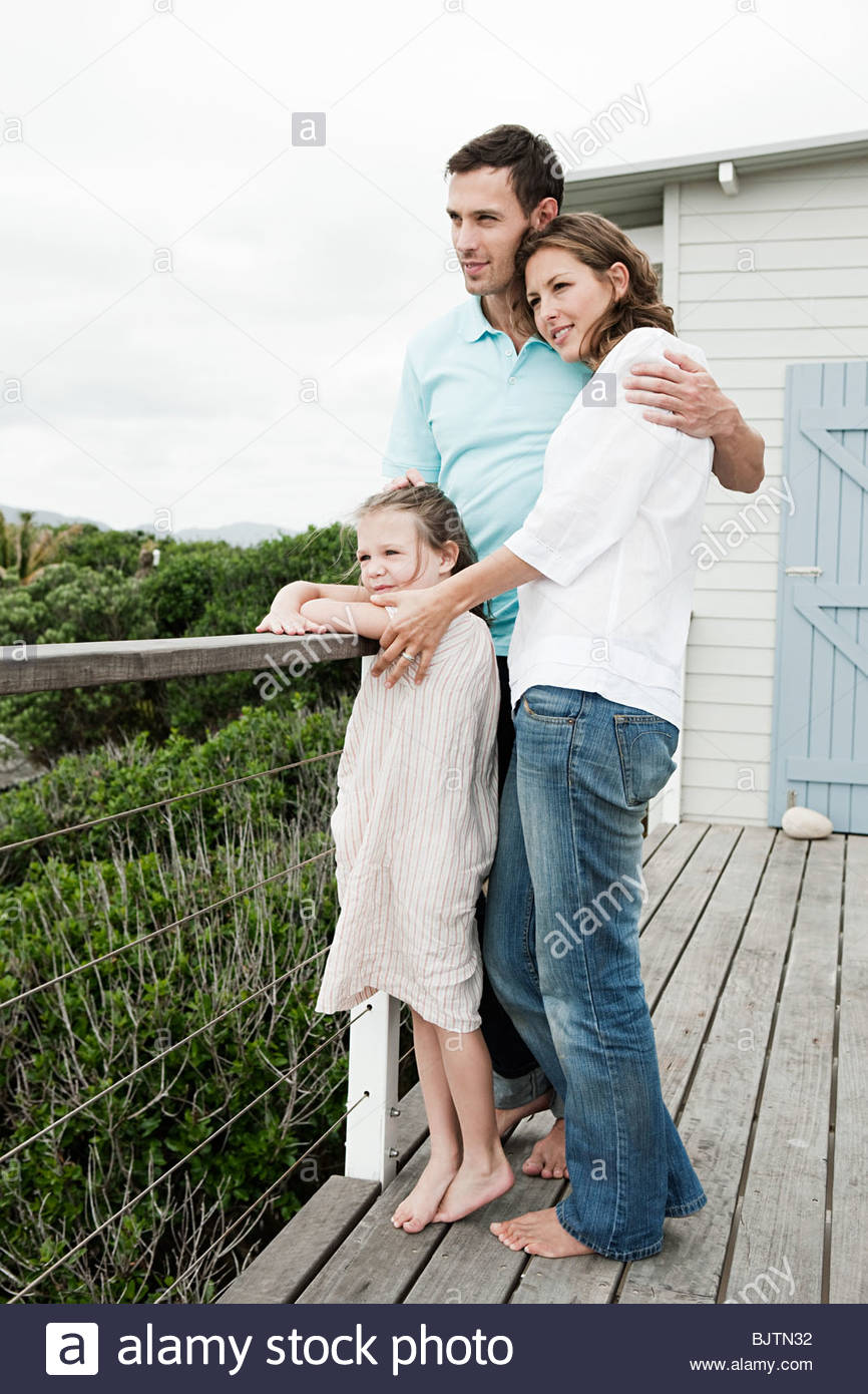 Girl and parents at holiday home - Stock Image