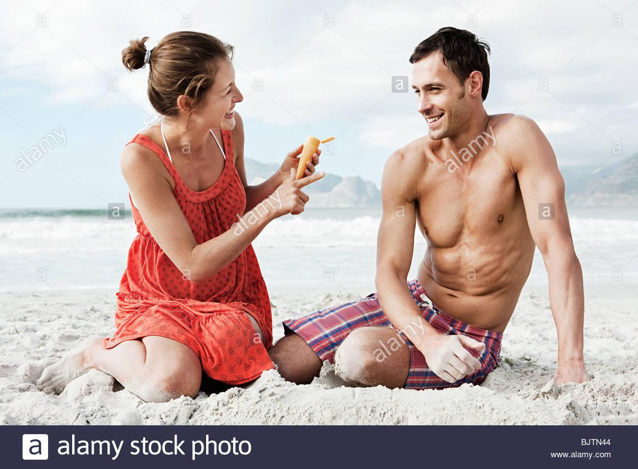 Couple with suncream - Stock Image