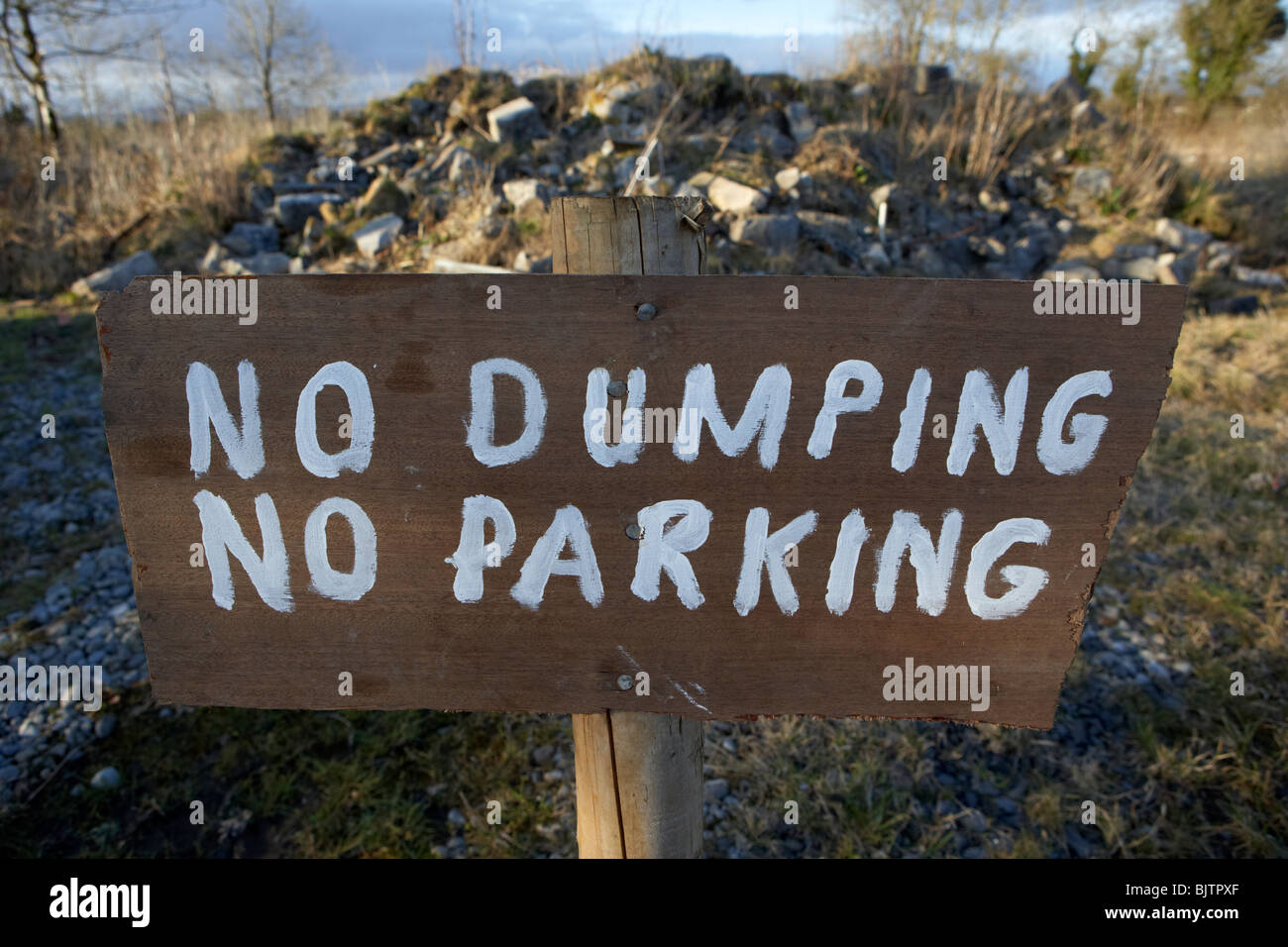 wooden hand painted no dumping no parking sign in county sligo republic of ireland - Stock Image