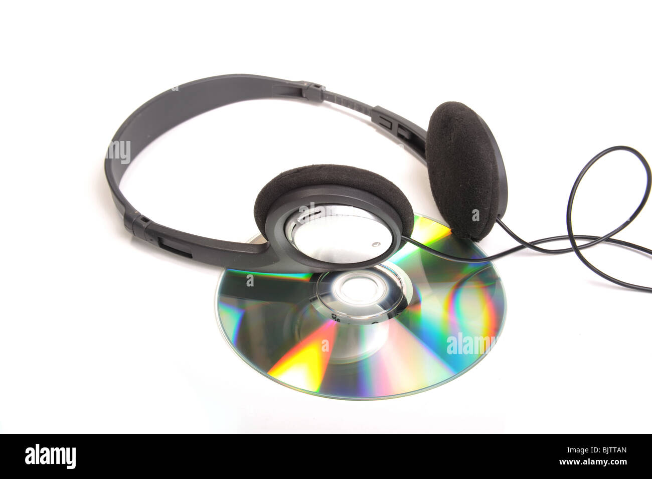 Head phones and compact disc photographed in studio against a whote background - Stock Image