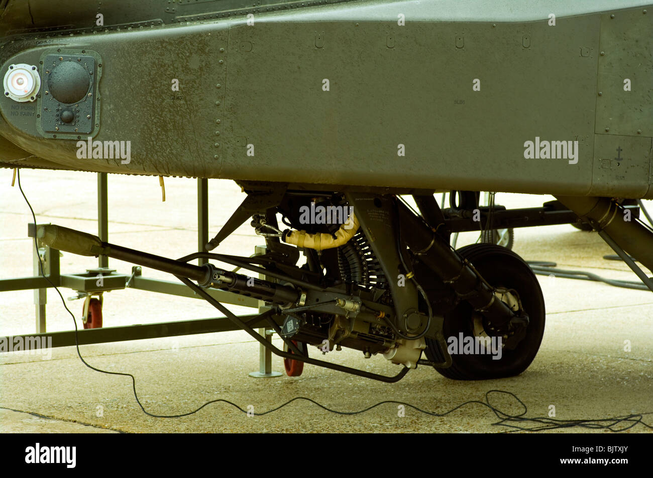 30mm Cannon On A British Army Westland Attack Helicopter WAH-64 MK1 Apache Longbow - Stock Image
