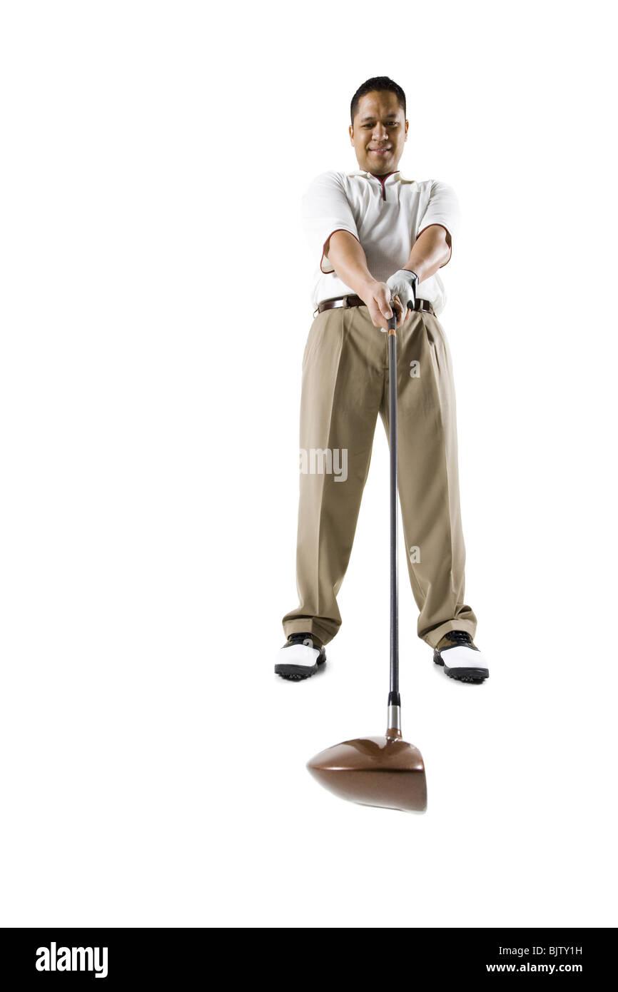 Golfer swinging club - Stock Image