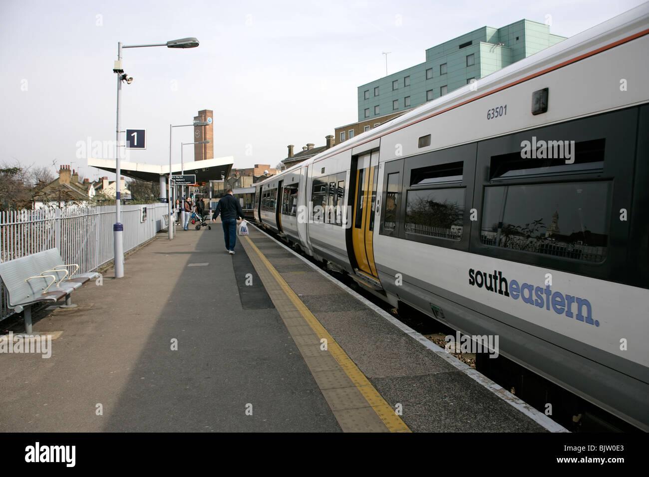 A Southeastern train at the station platform at Greenwich, London, UK - Stock Image
