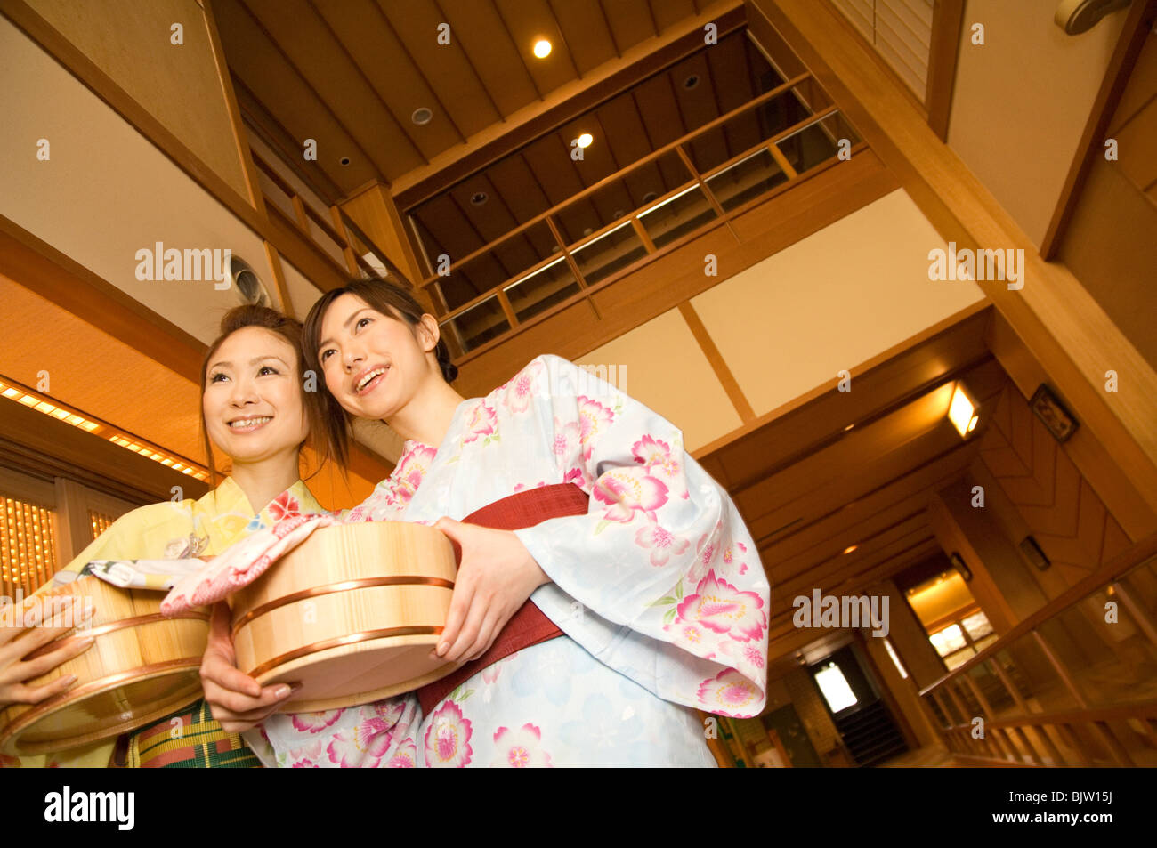 Two women wearing yukata and holding spa products at a health spa Stock Photo