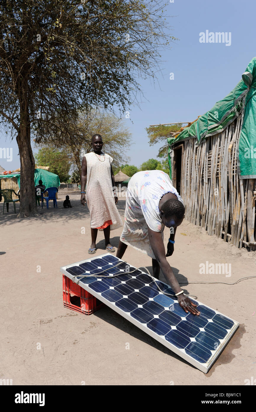 Africa Southern Sudan Rumbek , family use solar home system for electrification - Stock Image