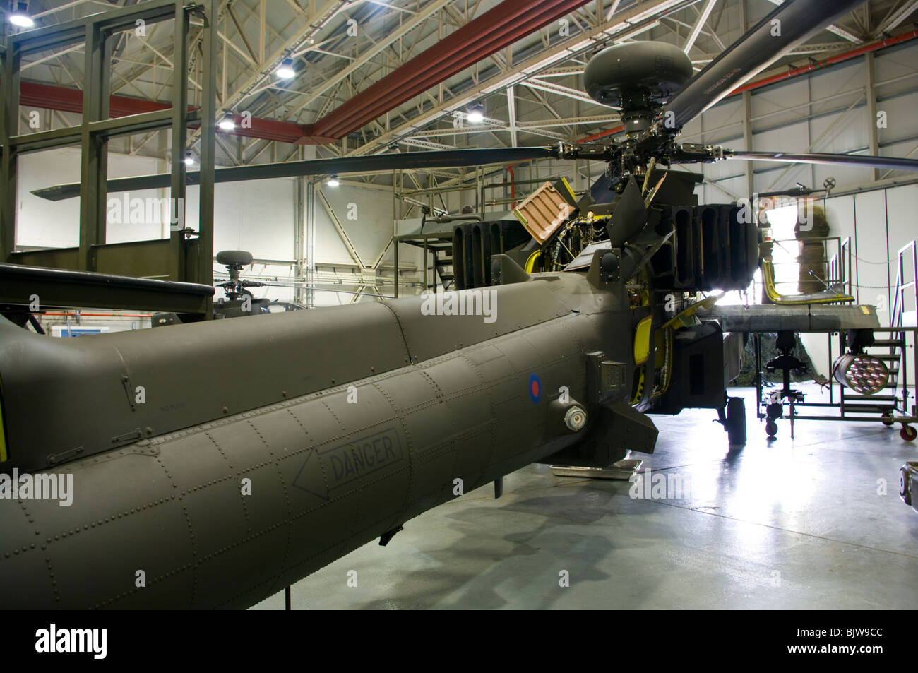 A British Army Westland Attack Helicopters WAH-64 MK1 Apache Longbow In A Maintenance Hanger Wattisham Airfield - Stock Image