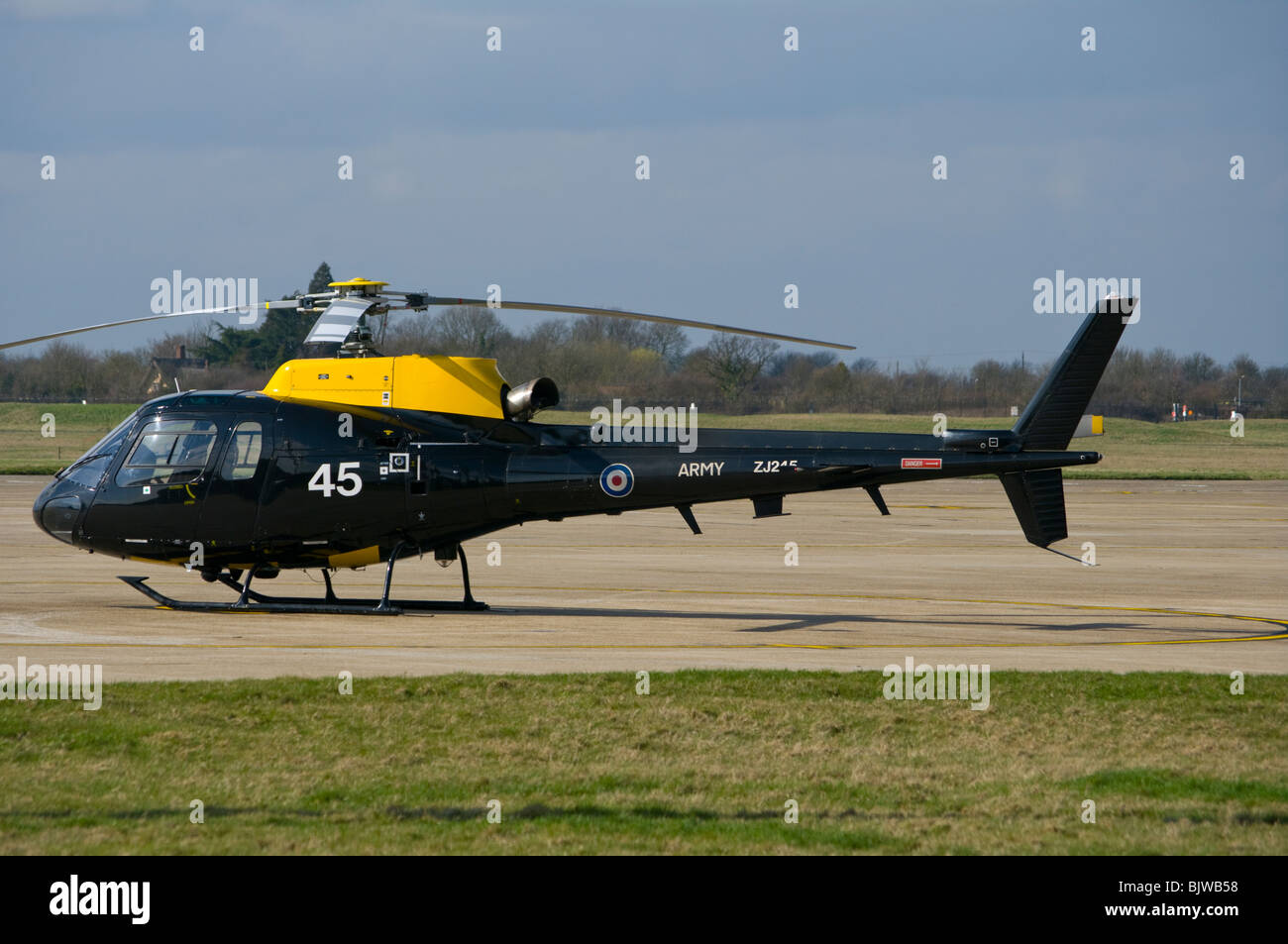 An Army Air Corps Squirrel Helicopter On The Tarmac At Wattisham Airfield Suffolk - Stock Image