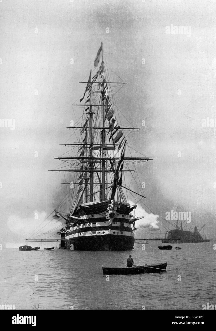 HMS 'Duke of Wellington' firing a Royal Salute as flagship at Portsmouth, Hampshire, 1896. - Stock Image
