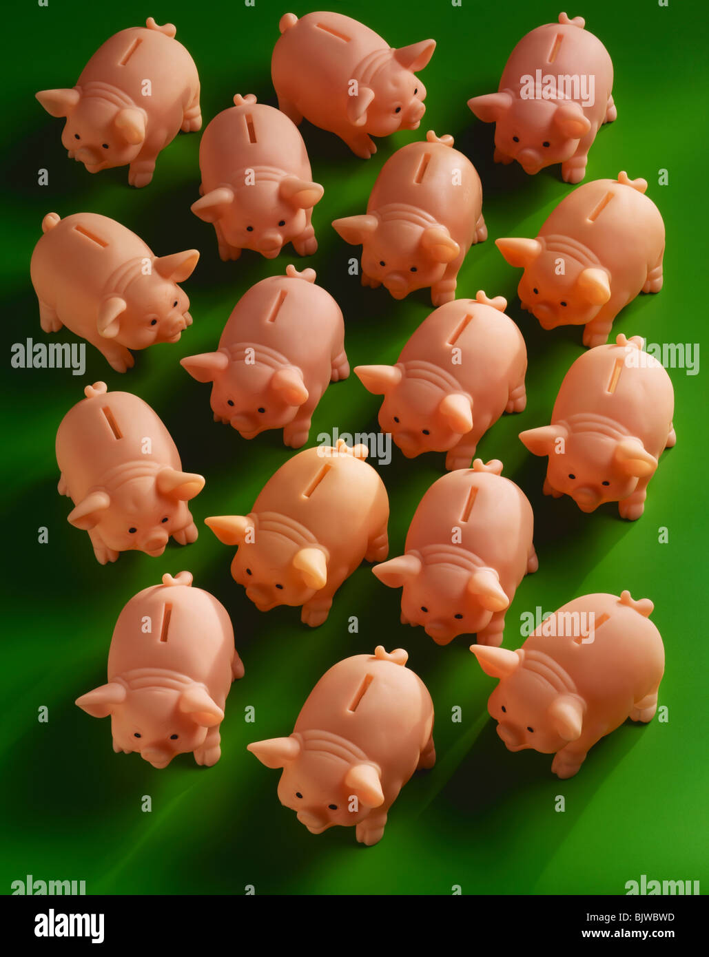 Herd of Piggy Banks - Stock Image
