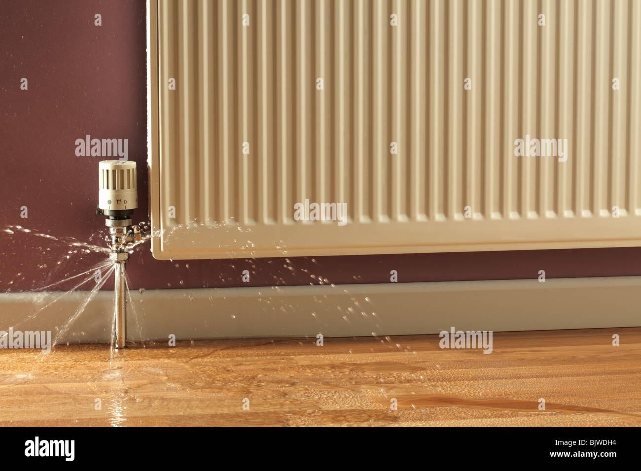 Leaking Radiator Pipes - Stock Image