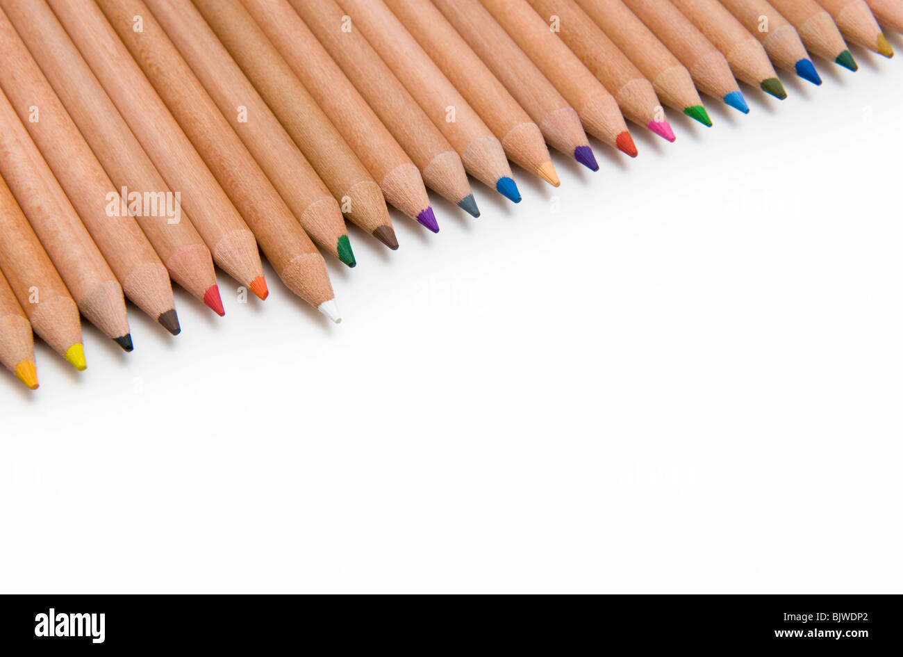 Line of Colouring Pencils on a White background With One White Pencil Standing Out - Stock Image