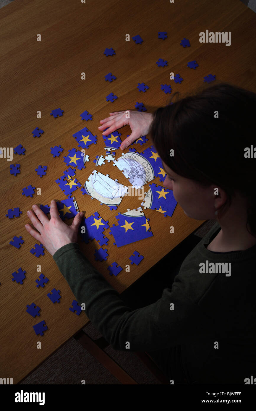 Puzzle with the emblem of the European Union and with Euro coin in the centre - Stock Image