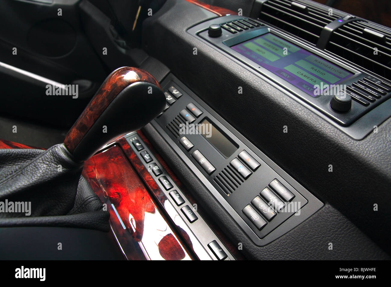 Modern luxury cars dashboard, with control buttons and multifunctional display. Shallow DOF. - Stock Image