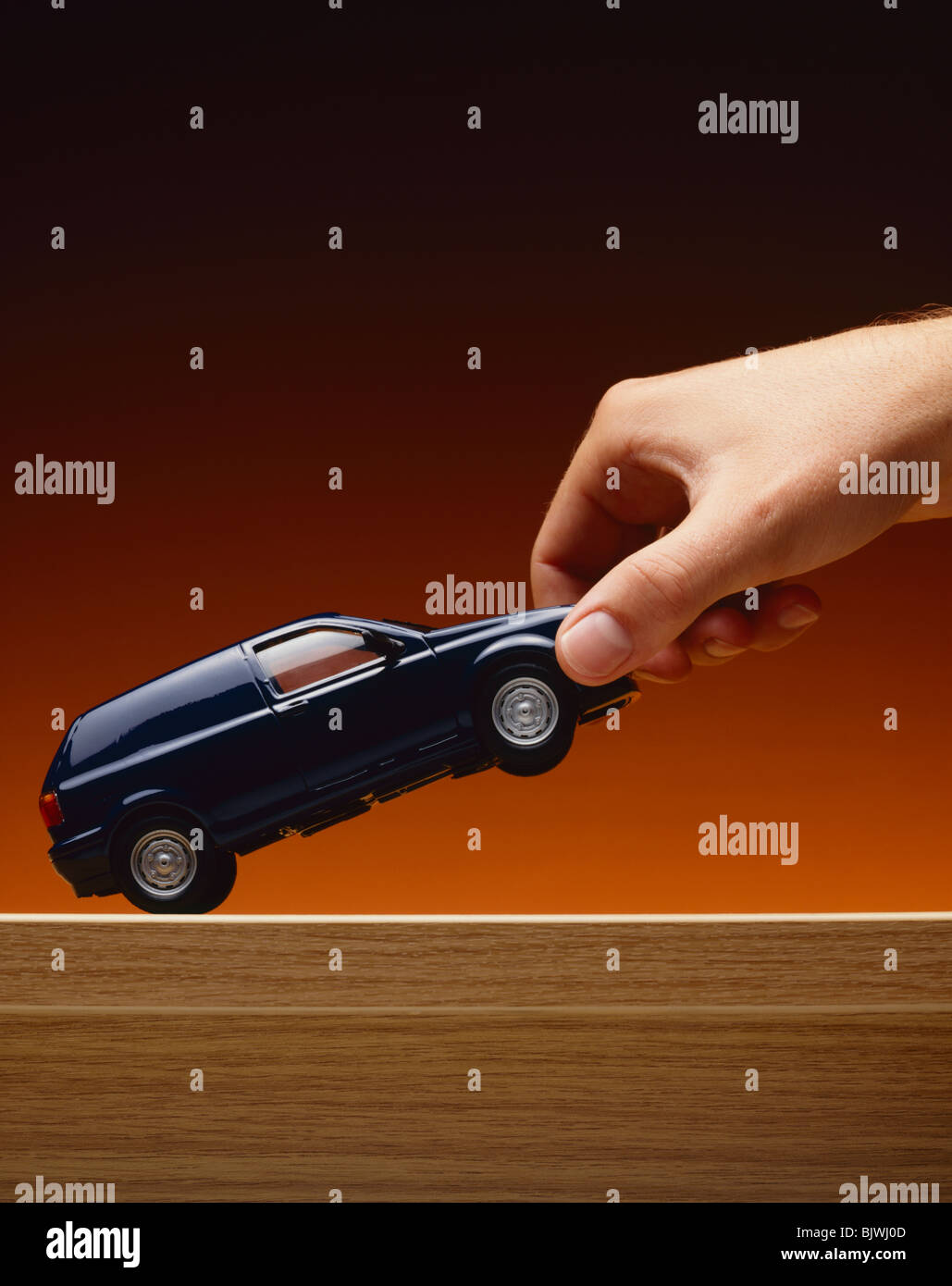 Hand Picking Up Model Van Stock Photo