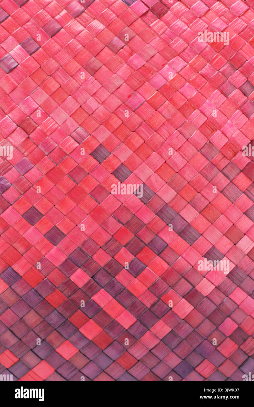 Close up of colored woven palm leaves mat background - Stock Image